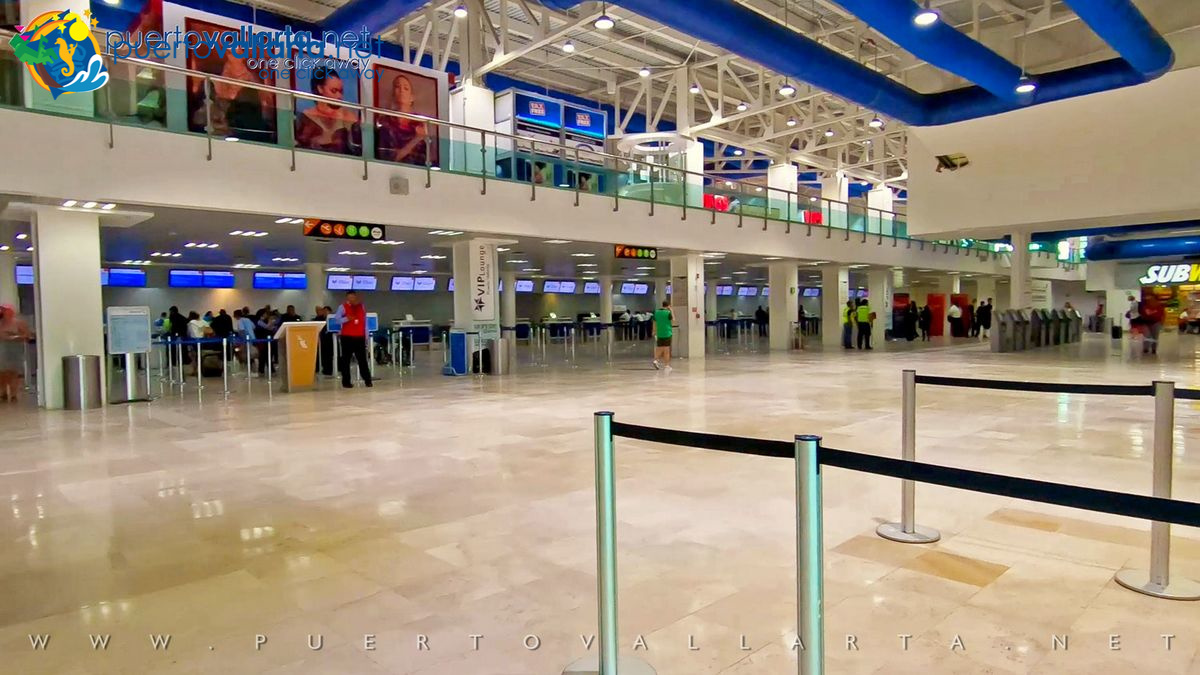 International check-in counters on the ground floor in the lobby of Terminal A