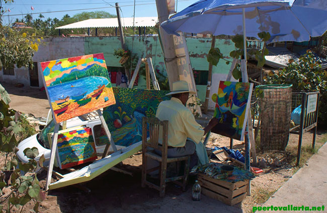 A local artist works by the bridge in Sayulita